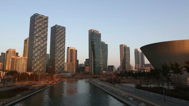Residential buildings stand next to Central Park in the Songdo district of Incheon South Korea on Saturday Jan 18 2014 Residential skyscraper...