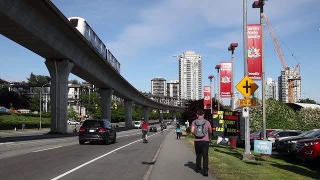 residential buildings stand under construction among other buildings in burnaby british columbia canada on monday june 3 2019 - hochbahn passagierzug stock-videos und b-roll-filmmaterial