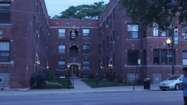 WS Residential courtyard apartment with traffic at night