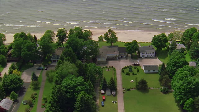 aerial residential district along beach, michigan - standing water yard stock videos & royalty-free footage