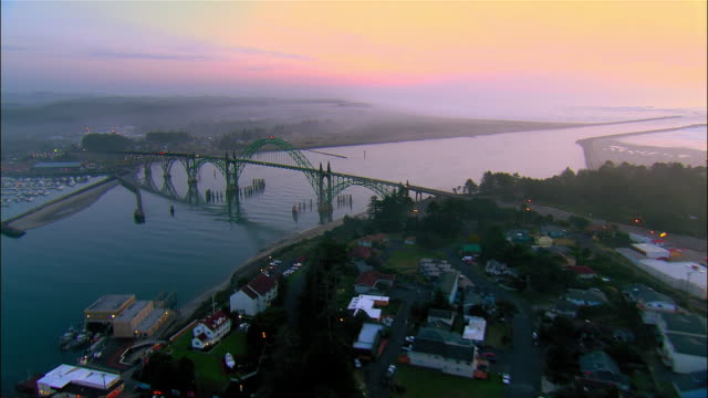 aerial residential district and  yaquina bay bridge, sunset, newport, oregon, usa - newport oregon stock videos & royalty-free footage