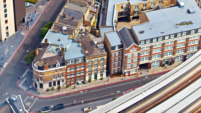 residential district in london. old fashioned retro buildings. aerial view. cars. highway. - road stock videos & royalty-free footage