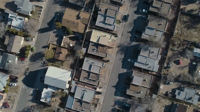 residential district of albuquerque, new mexico, on a sunny day in late november. aerial drone video with the ascending camera motion. - new mexico stock videos & royalty-free footage