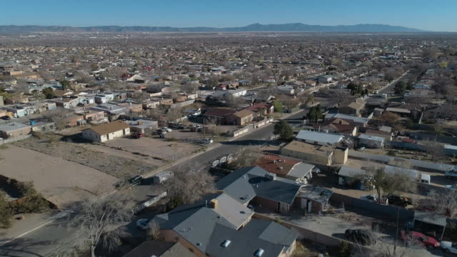 residential district of albuquerque, new mexico, on a sunny day in late november. aerial drone video with the descending camera motion. - albuquerque new mexico stock videos & royalty-free footage