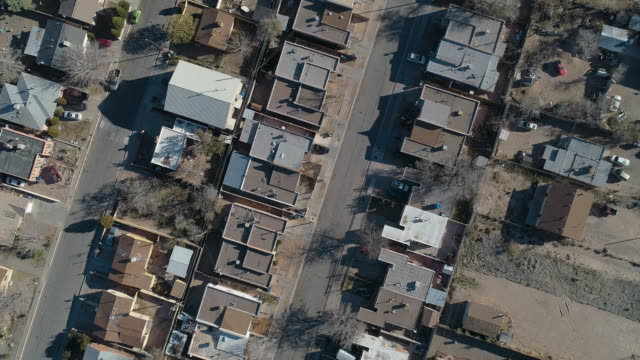 residential district of albuquerque, new mexico, on a sunny day in late november. aerial drone video with the panning camera motion. - albuquerque new mexico stock videos & royalty-free footage