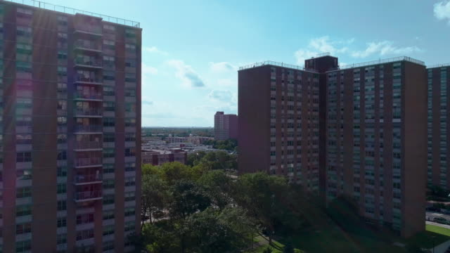 """residential district with multi-level social """"projects"""" brick buildings in brooklyn, new york, along pennsylvania avenue. aerial drone video with the descending camera motion. - council flat stock videos & royalty-free footage"""