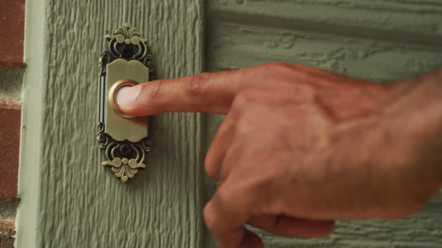 cu residential door bell; a man's finger reaches into frame and pushes the button several times. - door to door salesperson stock videos & royalty-free footage