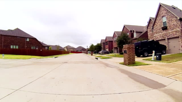 residential estate street driving - suburban stock videos and b-roll footage