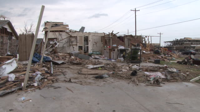 stockvideo's en b-roll-footage met a residential home is almost completely leveled in the wake of the devastating ef5 tornado in moore oklahoma on may 20th 2013 - 2013