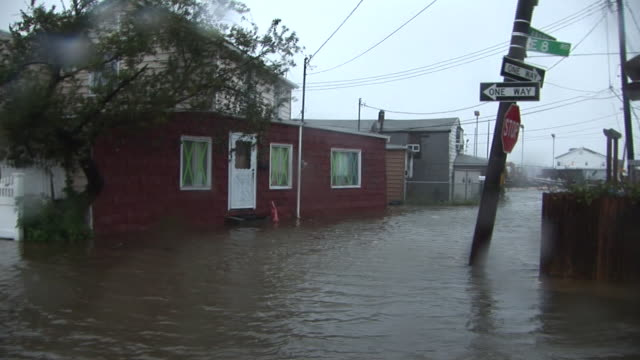 residential homes are surrounded and inundated by storm surge, as hurricane irene makes landfall in the new york city area. - hurricane irene stock videos & royalty-free footage