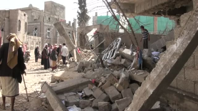 residential houses as well as a mosque and 22 may stadium have been destroyed as saudi-led coalition airstrikes targetting houthis hit residential... - air raid stock videos & royalty-free footage