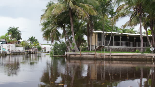 Residential houses on river in Everglades, shot from boat