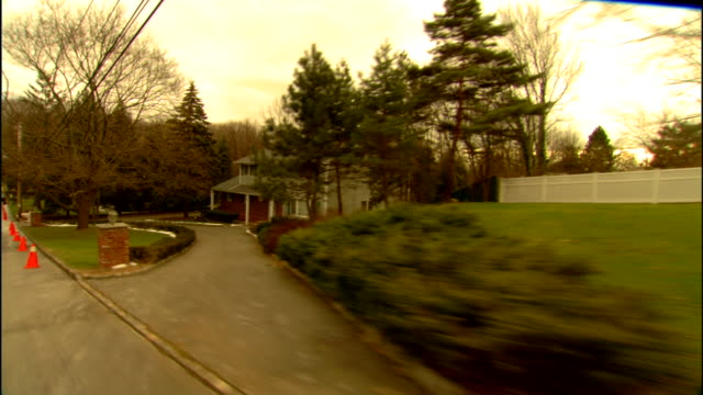 residential neighborhood large house front lawn w/ some snow trees orange traffic cones in street upper class suburban homes - orange new jersey stock videos & royalty-free footage
