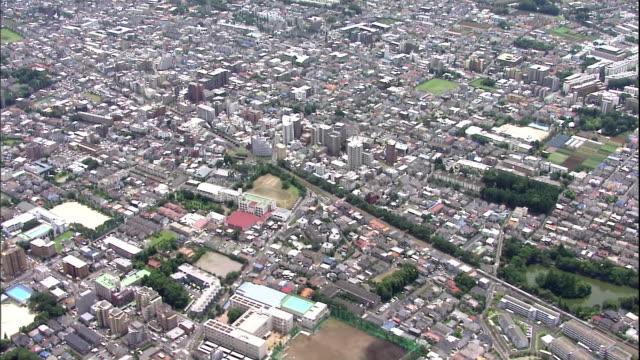 residential neighborhoods sprawl across tokyo's suginami and nishitokyo districts. - baseballfeld stock-videos und b-roll-filmmaterial