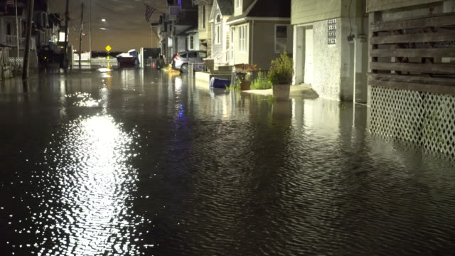 A residential street in Queens New York is submerged in tidal surge as Jamaica Bay overflows it's banks during the night time high tide cycle