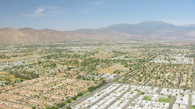 WS AERIAL POV Residential subdivisions looking east toward San Jacinto Mountains / Hemet, California, United States