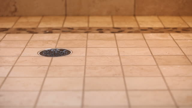 residential tiled shower drain with running water which stops - falling water stock videos & royalty-free footage