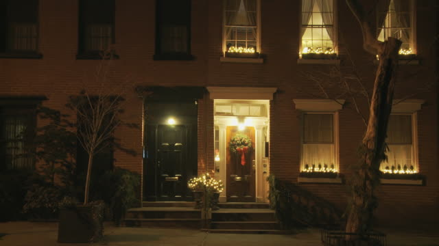 TS residential upscale townhouse doors with xmas decorations at night / New York, New York, USA