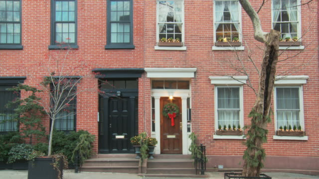 TS residential upscale townhouse doors with xmas decorations in daylight / New York, New York, USA