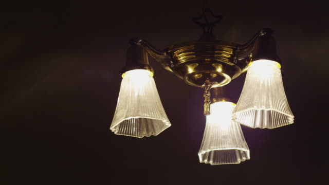 a residential vintage hanging ceiling light fixture in switched off. - 吊り照明点の映像素材/bロール