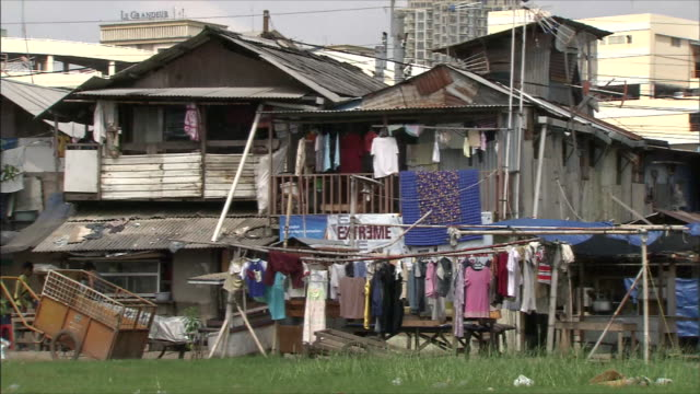 residential zone in a poor district a lot of clothes hung under eaves - eaves stock videos and b-roll footage