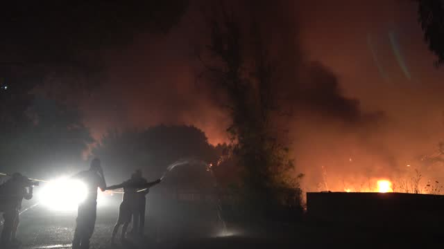 """residents are trying to extinguish the fire of a house that is seen burning, during wildfires in the """"nea kisisia"""" area located in the northern... - greece stock videos & royalty-free footage"""