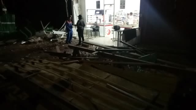 residents clean up debris caused by the earthquake at a mall after a magnitude 70 earthquake rocked neighbouring lombok island in bali's capital... - indonesia earthquake stock videos & royalty-free footage