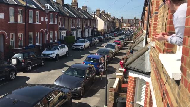 stockvideo's en b-roll-footage met residents facing their first day of covid-19 lockdown in windsor, england, sang happy birthday to you to a child turning 7 years old from their... - 18 19 years