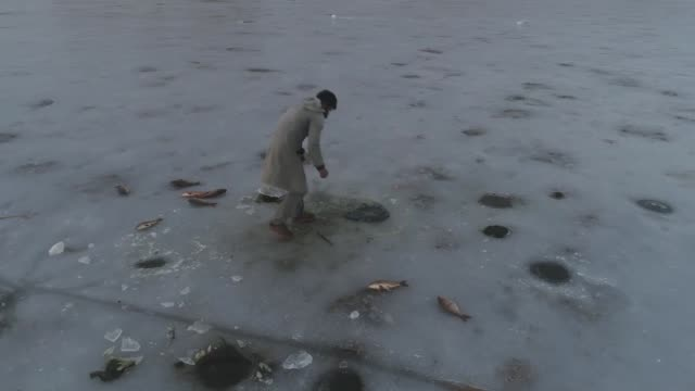 residents fishing over the frozen lake van as it has been frozen due to extreme cold weather during winter season in van turkey on december 28 2017... - lake van stock videos and b-roll footage