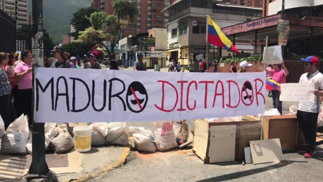 residents from the los dos caminos neighbourhood in caracas cut off roads to the traffic with house hold objects and bin bags filled with branches in... - venezuela stock videos & royalty-free footage
