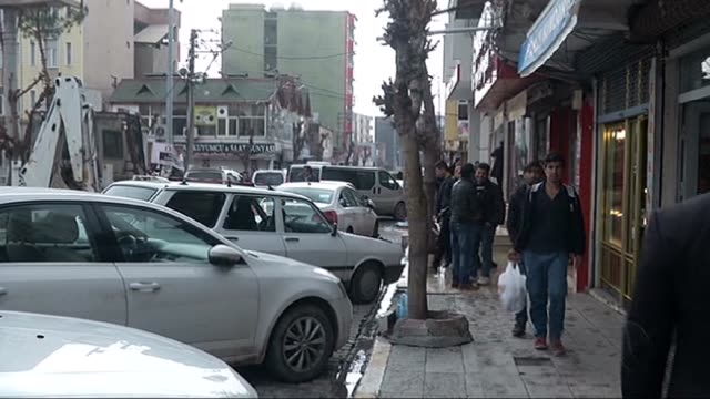 residents go for shopping after the curfew ended in the silopi district of sirnak turkey on january 19 2016 some of the shops and workplaces reopened... - silopi stock videos and b-roll footage