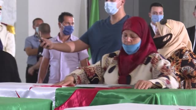 residents in algiers gather at the palace of culture to pay their respects to the 24 algerian resistance fighters decapitated during the french... - decapitated stock videos & royalty-free footage