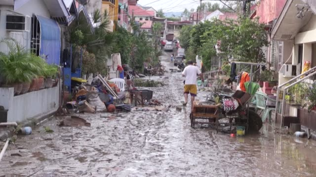 residents in batangas city, philippines start to return to their homes, which were soaked in mud after typhoon goni brought heavy rains, flooding... - vortex stock videos & royalty-free footage