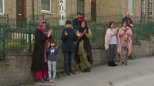 residents in bradford stand outside their houses to clap for carers and applaud all frontline workers during the coronavirus crisis - healthcare and medicine stock videos & royalty-free footage