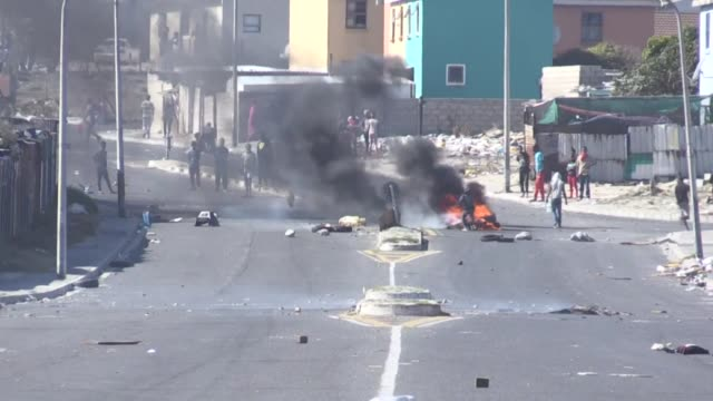 residents in cape town's low-income township of mitchells plain block roads and police fire rubber bullets in clashes during a protest demanding... - township stock videos & royalty-free footage