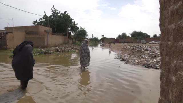 residents in niamey are building dams out of sandbags hoping to divert flood water after the niger basin authority issued a warning saturday of... - benin stock videos and b-roll footage