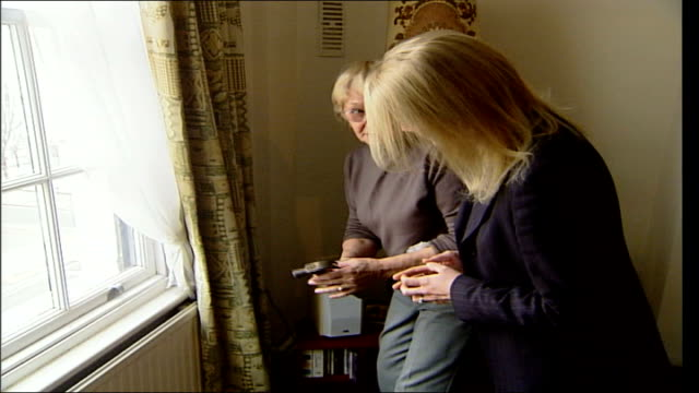 residents in pimlico sheltered housing left freezing by unreliable central heating england london pimlico int nadia kirkam speaking as thru doorway... - household fixture stock videos and b-roll footage
