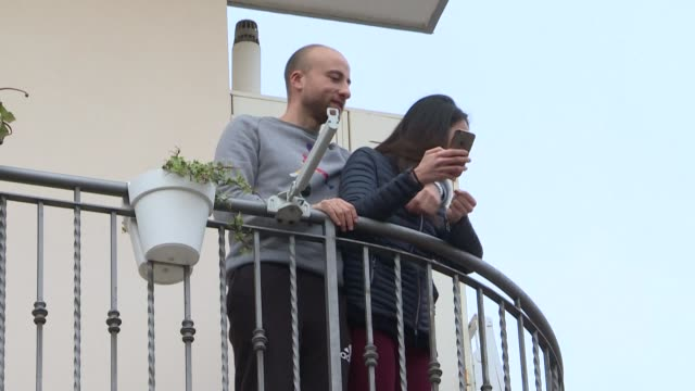 residents in rome sing from their balconies during another evening under lockdown as italy grapples with a coronavirus epidemic which has left 2,503... - isolamento video stock e b–roll