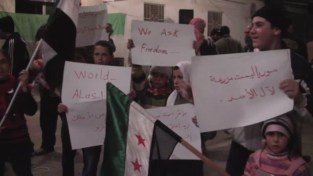 residents of al qusayr, take part in night time neighborhood demonstrations against president bashir al assads regime, following the evening prayers.... - revolution stock videos & royalty-free footage