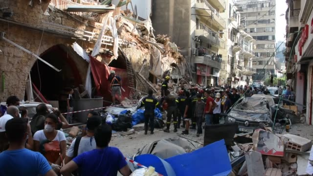 residents of beirut have been mobilized to clear rubble and glass from streets after devastating ammonium nitrate explosion which damaged half the... - explosion stock-videos und b-roll-filmmaterial