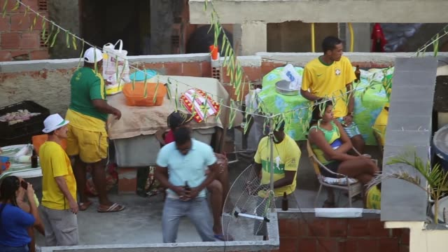 residents of cantagalo favela watch as their team defeats colombia, making it to the next round of the fifa 2014 world cup, shot in cantagalo favela,... - ゴールを狙う点の映像素材/bロール
