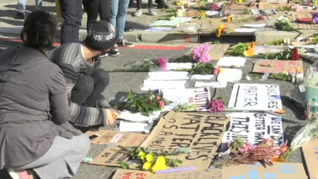 residents of cape town lay out placards as they partake in a worldwide series of protests in the wake of the death in police custody of... - racism stock videos & royalty-free footage