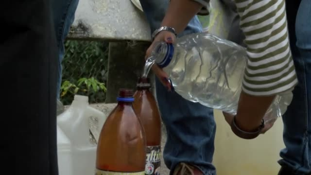residents of caracas collecting and storing rainwater after resources become scarce in venezuela - collection stock videos & royalty-free footage