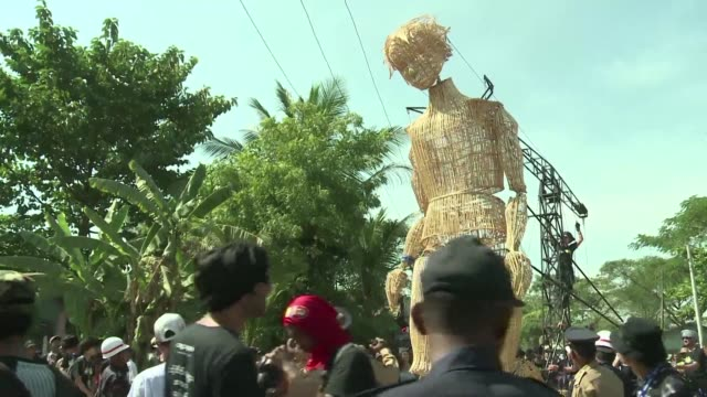 Residents of Dala township a suburb of Myanmar's commercial capital Yangon receive an unusual visitor on Friday as a giant wooden puppet strolls...
