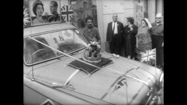 stockvideo's en b-roll-footage met residents of gibraltar line up to vote showing v for victory signs for cameras / pictures of queen elizabeth and prince phillip / car covered in... - alle vlaggen van europa