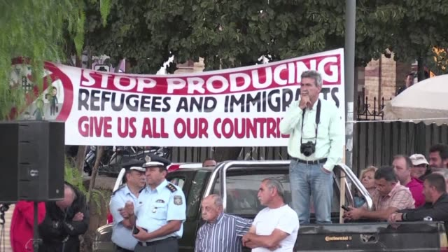 residents of greece's chios island hold and anti migrant rally as the eu says it hopes to relocate 30,000 refugees from the country by the end of... - greece stock videos & royalty-free footage