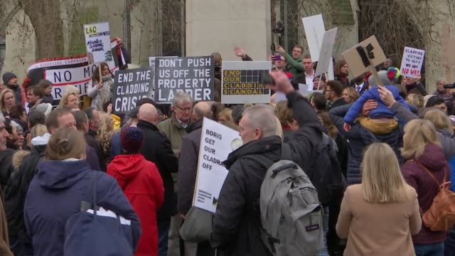 residents of high rises demand any potentially flammable cladding removed; england: london: westminster: ext assembled protesters with placards... - flammable stock videos & royalty-free footage
