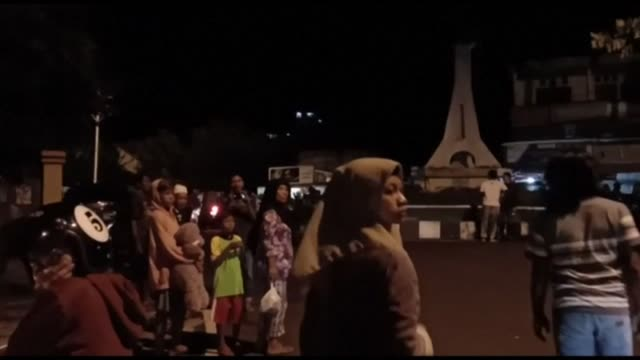 residents of indonesia's north maluku province come out into the streets after a strong 69 magnitude quake struck in the molucca sea off indonesia... - indonesia earthquake stock videos & royalty-free footage
