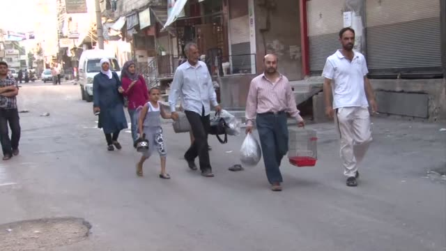 residents of kashkoul neighbourhood in the countryside of damascus slowly ventured out of their homes on tuesday after syrian regime forces launched... - franchising stock videos and b-roll footage