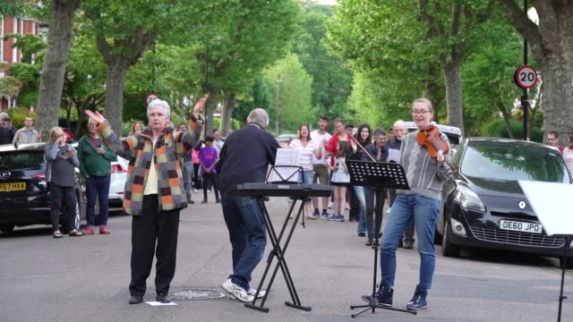 slomo residents of park avenue north n8 in crouch end come out every thursday to sing 'lean on me' by bill withers on may 7th 2020 in london england... - bill withers stock videos & royalty-free footage